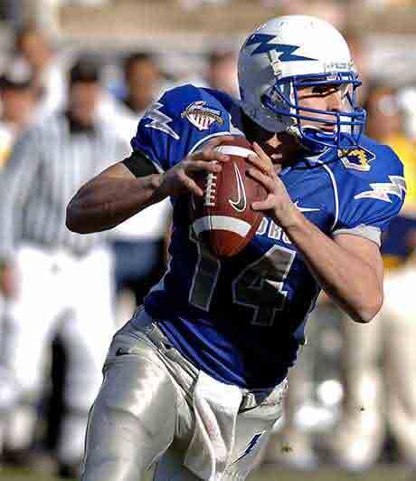 American football helmet in the hand